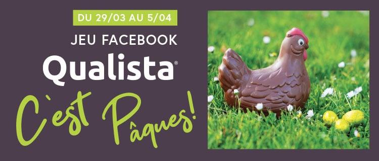 jeu concours Facebook de Pâques Qualista illustré par une poule en chocolat dans l'herbe avec des oeufs